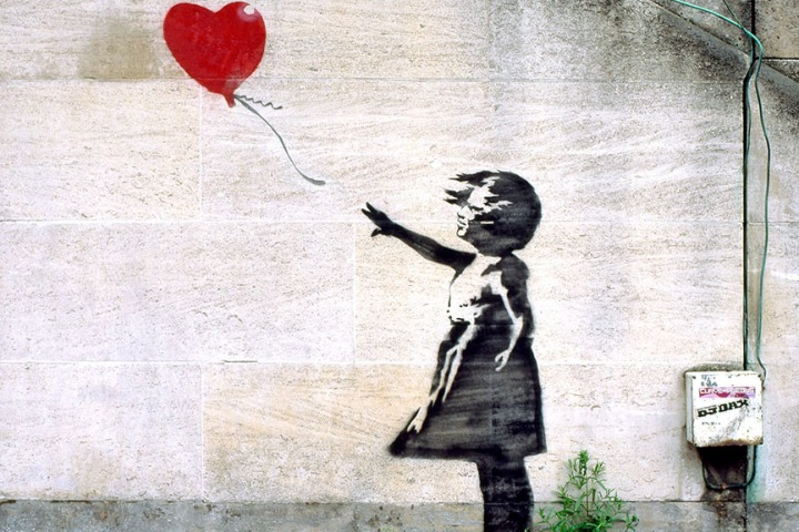 Banksy%u2019s-Girl-with-Balloon-on-a-South-Bank-wall-near-the-National-Theatre-in-2004.-Photograph-Alamy